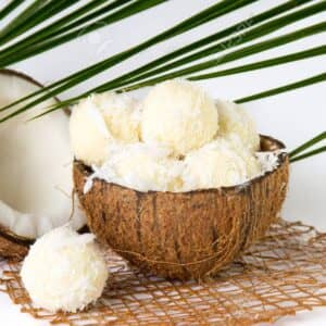 81785735 coconut ice cream in a coco shell on white 300x300 1